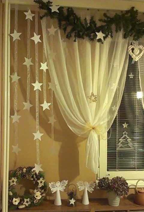 podveska so zvezdami na okne